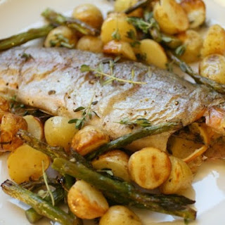 Whole Roast Trout with Potatoes and Asparagus.