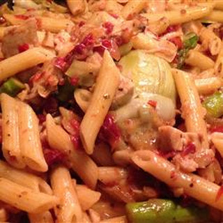 Chicken Penne with Asparagus, Sun-dried Tomatoes, and Artichoke Hearts.