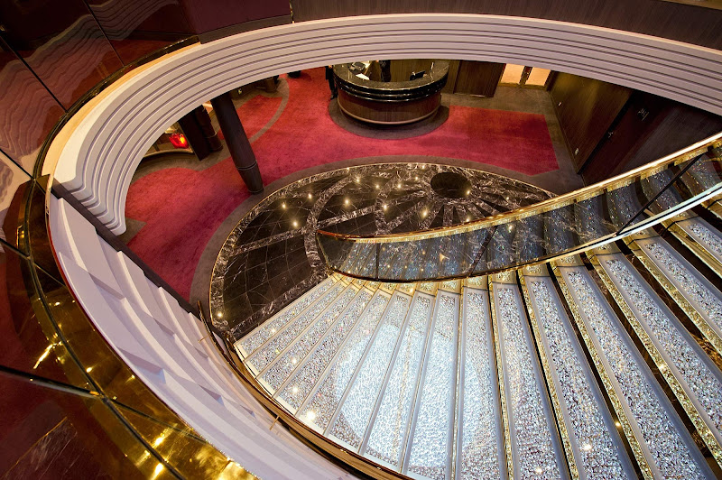 A Swarovski crystal chandelier reflects on the grand staircase inside the MSC Yacht Club area aboard MSC Divina.