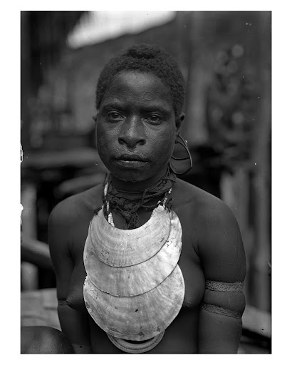 Woman wearing shell wealth items, Kaimare village, Gulf Province, October 1922