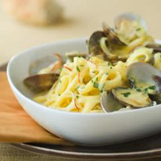 Linguine with Clams in Saffron Alfredo Sauce.