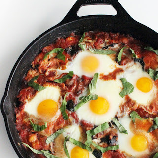 Poached Eggs With Tomato, Swiss Chard, and Chickpeas.