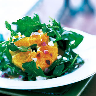 Arugula Salad With, Oranges, Pomegranate Seeds, and Goat Cheese