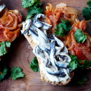 Marinated Anchovy Sandwiches with Tomato-Onion Sauce.