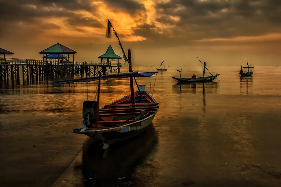 In the morning by Agus Sudharnoko - Transportation Boats