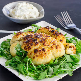 Roasted Head of Cauliflower with Blue Cheese and Sour Cream Dip.