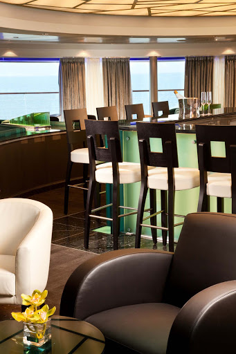 Panoramic views greet guests as they gather for early morning risers' coffee and tea in the Observation Bar on Seabourn Sojourn.