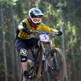 Morgan Charre of France at the Cascades World Cup Ladies elite downhill. Look at th expression on her face, aggression.  by Simon Joubert - Sports & Fitness Cycling ( mountainbike, world cup, kwazulu-natal, downhill, cycling, mtb, south africa, uci, cascades, simon joubert )