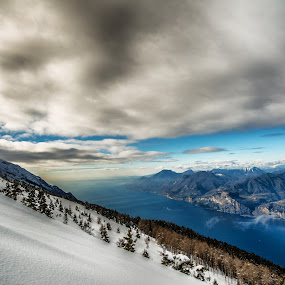 Beetwen Sky and Earth. by Mattia Bonavida - Landscapes Mountains & Hills ( garda, cluds, forest, lake, landscape, d800e, mountains, sky, winter, nature, snow, trees, nikon, italy )