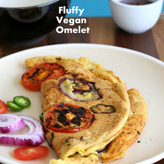 Chickpea flour Vegan Omelet with Onions and Tomato slices.