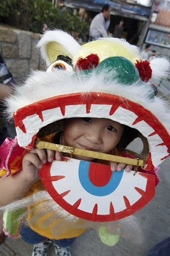 Hong-Kong-child - A young reveler in Hong Kong.