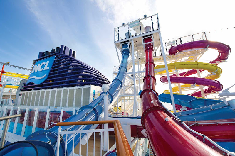 Enjoy a swift drop slide experience inside Norwegian Breakaway's Aqua Park, home to several multi-story slides and pools.