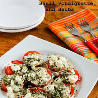 Summer Tomato Salad with Goat Cheese, Basil Vinaigrette, and Fresh Herbs.
