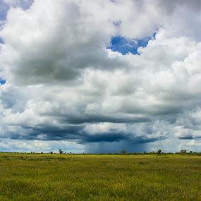 Clouds opening up by Arun Prasanna - Landscapes Cloud Formations ( #rain #distant clouds #kalahari #sky )