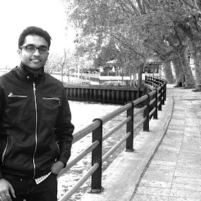 By the riverside by Sandip Roy - People Portraits of Men