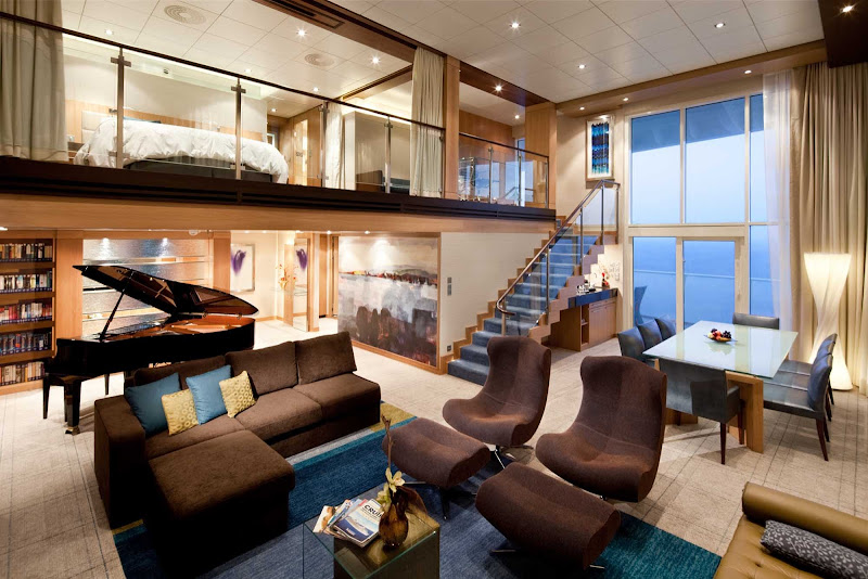 The Royal Loft Suite aboard Oasis of the Seas offers guests a two-story room with panoramic views, a master bath and bedroom, twin beds that convert to a Royal King bed, separate bathroom, a private balcony and whirlpool, spacious dining room  and more.