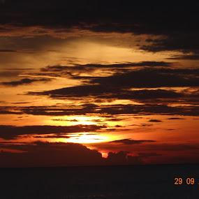 Clouds caressing the sky during Sunset at Kanyakumari by Shubha Mishra - Landscapes Sunsets & Sunrises ( clouds, orange, skyline, sky, nature, sunset, beach, dusk, sun rays, sun,  )