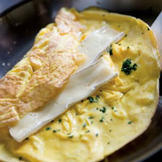 Lots-of-Herbs Omelette Stuffed with Brie.