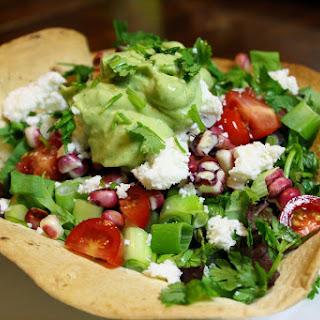 Taco Salad In Tortilla Bowls With Avocado Dressing.