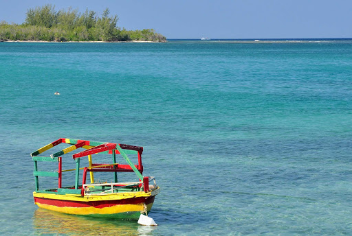 color-boat-Falmouth-Jamaica - A scene along the beach and tropical waters of Falmouth, a popular cruise destination in Jamaica.