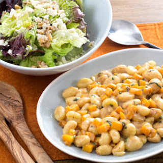 Brown Butter & Roasted Squash Gnocchi with Red Leaf Lettuce, Ricotta Salata & Walnut Salad
