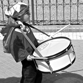 by Venetia Featherstone-Witty - People Street & Candids ( street candid, child candid, little drummer boy, black and white, drummer, boy with drum, portrait of child, child drummer, portrait,  )
