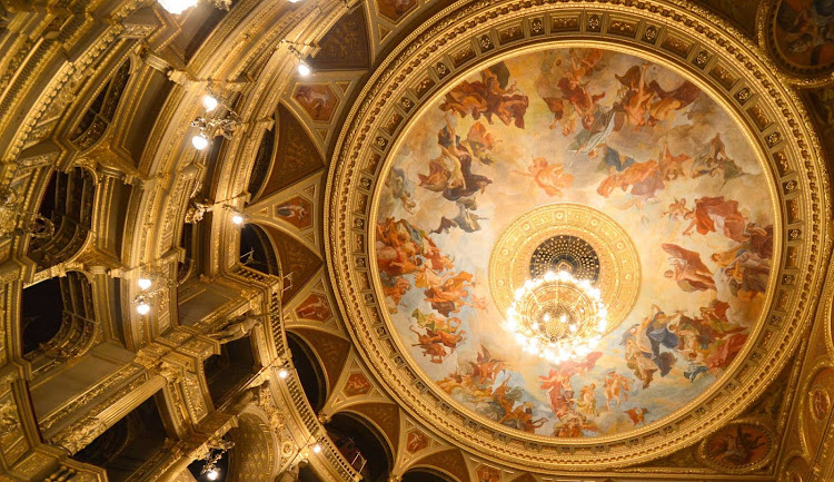 A capture of the decorative Opera House ceiling in Budapest, Hungary.