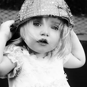 peyton sparkle hat on trampoline.jpg