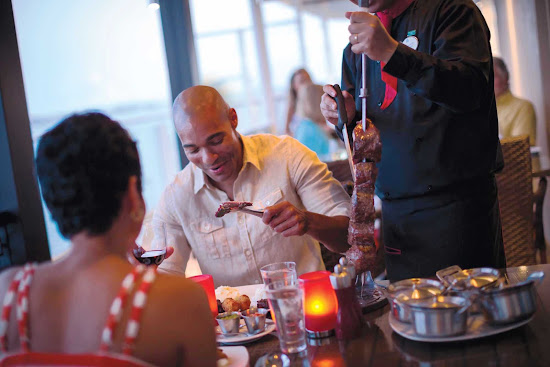 At Norwegian Breakaway's specialty restaurant Moderno Churascaria, you can enjoy delicious roasted meats carved at tableside.