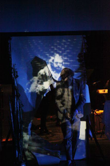 <p> <em>&#39;Language is a Virus from Outer Space&#39; by Richard Strange and Gavin Bryars at the Queen Elizabeth Hall, Southbank, London, Oct 2014</em></p> <p> Pictured is Gavin Turk as Allan Ginsberg, cutting through a projection of himself to enter the stage.</p>