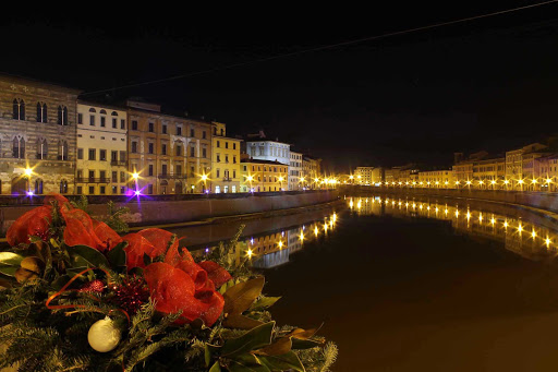 The River Arno in Pisa, Italy, at night.