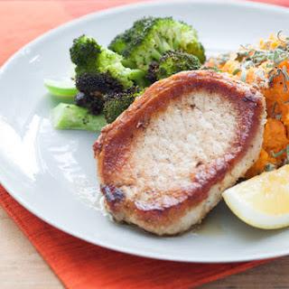 Pork Chops with Smashed Sweet Potato, Roasted Broccoli & Herbs.