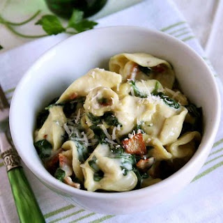 Tortellini with Crispy Bacon and Spinach in Cream Sauce.