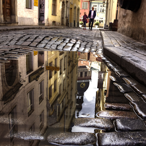 A puddle by Julija Moroza Broberg - City,  Street & Park  Historic Districts ( old house, reflection, person, walking, brick wall, street art, street, old city, old town, house, sihloutte, people, city, city view, family, after rain, bricks, rain, water, houses, city life, latvia, old building, street photography, riga, old street, two, puddle, town, street scenes )