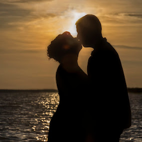 Sunset romance by Kimberly Arend Porter - People Couples ( kiss, marriage photography, silhouette, sunsets, romantic, sun flare )