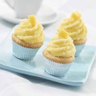 Luscious Vanilla Mini Cupcakes With Mango Buttercream.
