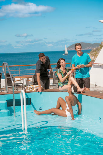 Take a dip in the pool on Tere Moana's pool deck during your Paul Gauguin cruise.
