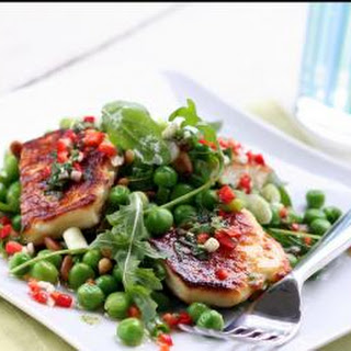 Grilled Halloumi With Peas, Pine Nuts, Broad Beans And Rocket.