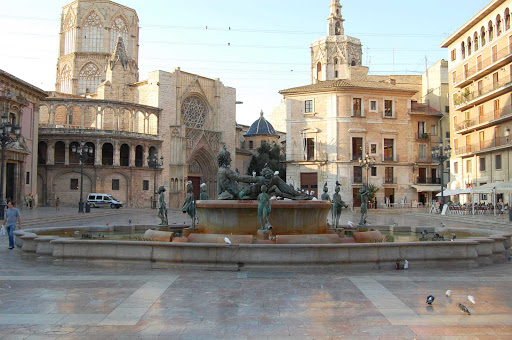Valencia-Spain-townsquare - A fountain at the center of a townsquare in Valencia, Spain.