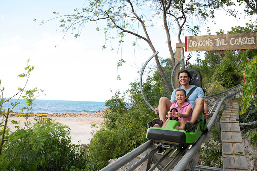 Daughter and dad take a rollercoaster ride in Labadee, Royal Caribbean's private beach resort on Haiti's north coast.