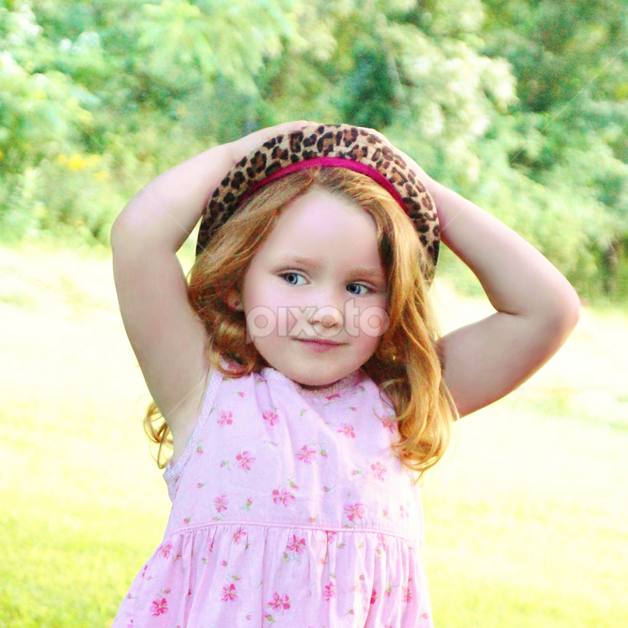 Wind's Blowing My Hat!  by Cheryl Korotky - Babies & Children Child Portraits ( pose, a heartbeat in time photography, child model nevaeh, leopard print hat, portrait )