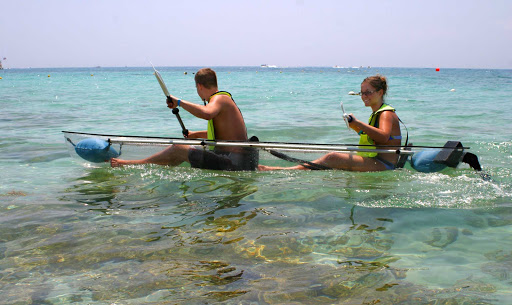 Clear kayaks, available for rent at Cozumel beaches, let visitors pilot their own glass-bottom boat over reefs.
