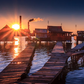 Sunset fishing houses on a lake in Bokod by Zoltan Duray - Landscapes Waterscapes ( water, hungary, building, oroszlany, lake, house, sun, sky, sunset, pier, summer, fishing, magyarorszag, bokod,  )