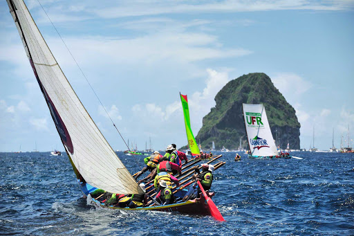 """A Yole or """"gig,"""" meaning an elongated boat, is featured in a festive regatta during Martinique's traditional island Carnival."""