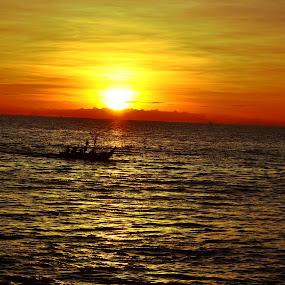 Pulang di senja by Alvi Eko Pratama - Landscapes Sunsets & Sunrises ( water, red, sunset, landscape, sun )