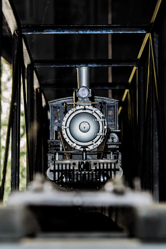 Toy Engine on a bridge by Scott Morgan - Artistic Objects Toys ( toy, engine, railroad, bridge, black, steam, object,  )