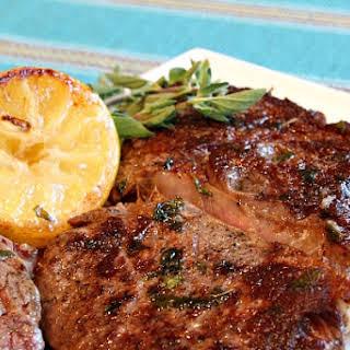 Pan Fried Lemon- Garlic Rib Eye Steaks.