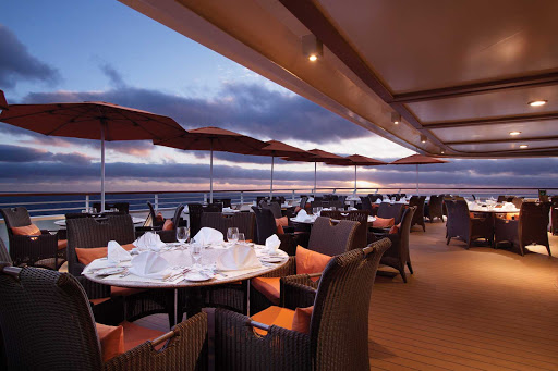 Whether at sunset or sunrise, the patio of the Terrace Café makes an ideal location to enjoy a meal while soaking up the view on Oceania's Riviera.