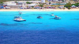 Houses and hotels line the shoreline on Grand Turk in Turks and Caicos.
