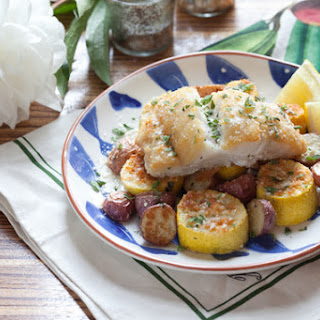 Pan-Seared Cod with Parmesan-Crusted Squash & Roasted Red Potatoes.